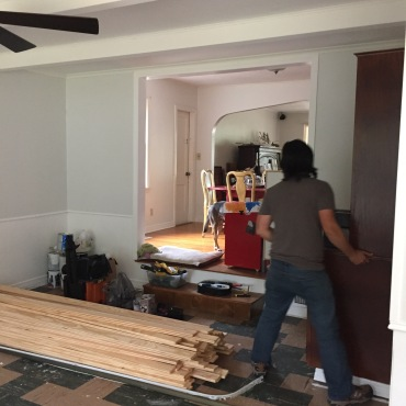 piles of lumber everywhere. DK removing shelving that's built into the walls.
