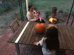 sitting by the fire to carve pumkins