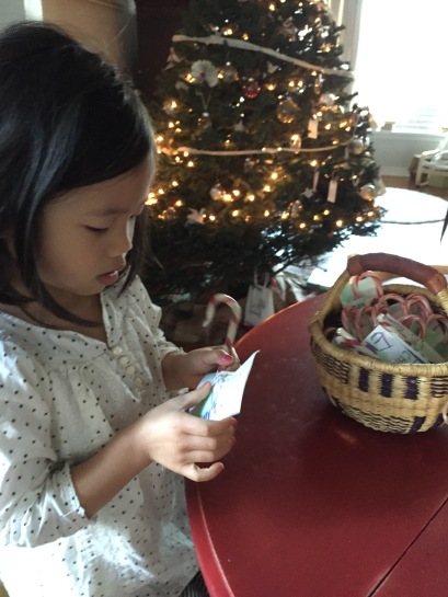 Proud of Emmy's efforts to make her own stocking stuffers. Her ideas were a bit beyond our reach this year, no handmade notepads but cute little watercolored tags for her candy canes.